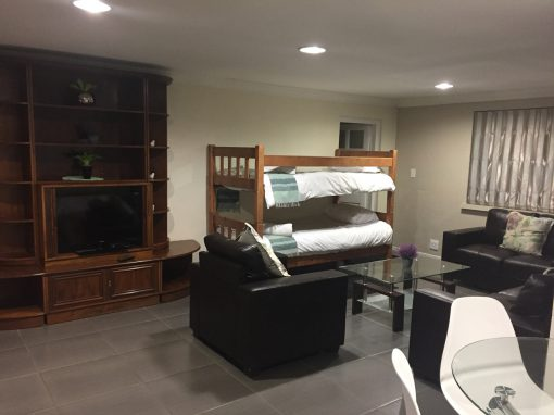 big-morning-hill-unit-guest-house-large-cottage-lounge-with-beds-2